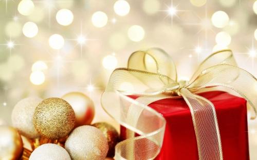Christmas gift on defocused lights background