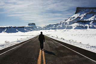 Man Walking Deserted HIghway in Utah