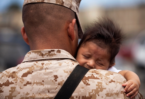 Cpl. Antonio Tellez, an administrative clerk with Headquarters Battery, 1st Battalion, 12th Marine Regiment, holds his 3-month-old son before departing Marine Corps Base Hawaii on a seven-month deployment to Afghanistan in support of Operation Enduring Freedom, April 25, 2011. Over the course of the week, approximately 550 Marine and sailors from 1/12 departed Hawaii to replace 1st Battalion, 10th Marine Regiment, in Afghanistan's Helmand province. Unlike their last two deployments — supporting Task Forces Military Police in Iraq — 1/12 will revert back to its primary mission and provide artillery fire support to 2nd Marine Division (Forward) during ongoing counterinsurgency operations in the province.